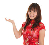 Chinese cheongsam girl showing blank space