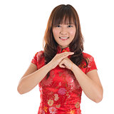 Chinese cheongsam girl greeting