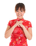 Chinese cheongsam woman greeting