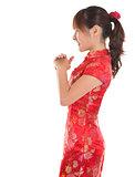 Side view Chinese cheongsam girl greeting