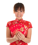 Chinese cheongsam girl holding red packets