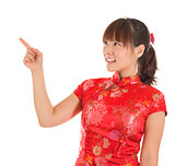 Chinese cheongsam girl finger pointing