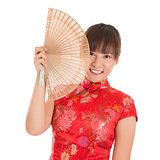Chinese cheongsam woman with fan