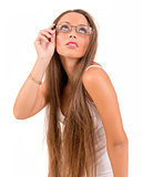 Beautiful woman with glasses looking up in a bwhite background