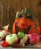 Halloween pumpkin Jack O'Lantern with fruit and sweets