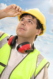 Engineer or builder looking up at progress