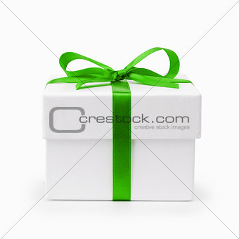white textured gift box with green ribbon bow