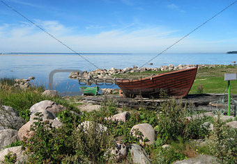 Fishing boat on the shore on a wooden platform