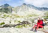 woman backpacker at Five Spis Tarns, Vysoke Tatry (High Tatras),