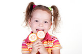 Cute fun little girl holding lolly pop