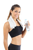 Beautiful fitness woman with a towel and a bottle of water