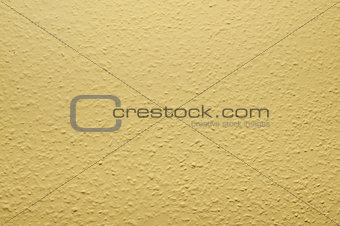 pale yellow structural painted wallpaper on the wall