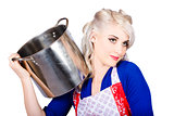Beautiful young housewife holding kitchen utensils