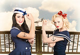 Vintage pinup style. Two retro sailor pinup girls
