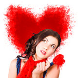 Photo of romantic woman holding heart shape candy