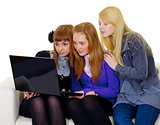Female teenagers with a laptop