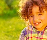 Cheerful child on summer field