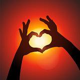 Love shape hands silhouette in sky, vector Eps10 illustration.