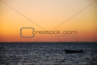 Alone boat in sunset