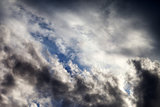 Sky with sunlight and dark clouds