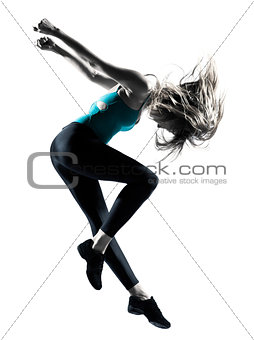 Blond haired woman doing gymnastic jump