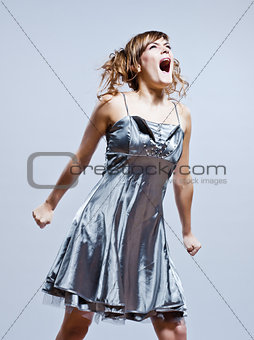 beautiful young girl with prom dress screaming anger