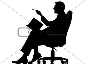 one business man with personal agenda taking notes sitting in ar