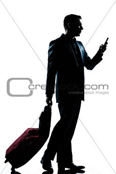 business traveler man walking with telephone and  suitcase