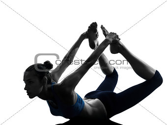 woman exercising yoga bow pose