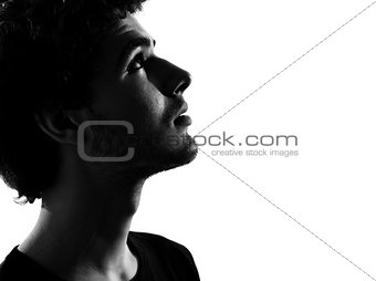 young man silhouette anxious looking up