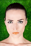 Portrait of a serious beautiful woman with green eyes and glossy