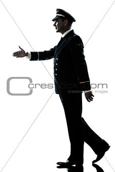 man in airline pilot uniform silhouette walking handshake
