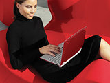 woman with laptop on the sofa a