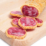 fuet, spanish sausage, coated with onion