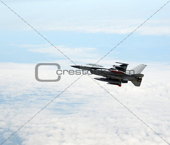 Jet fighter at altitude