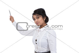 Beautiful Asian businesswoman pointing with a pen
