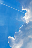 cloudscape with trace of air plane