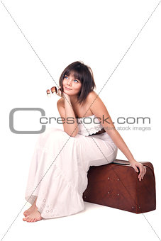 Beautiful girl sitting on sutcase