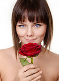 Portrait of beautiful girl with rose