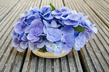 Bouquet of hydrangea on rustic wood