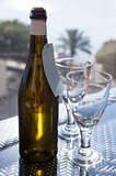 Wine bottle with a two glasses on the outdoor background