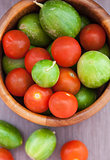 Assorted fresh colorful cucumbers and  cherry tomatoes