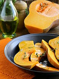 pumpkin baked with herbs and spices in a pan
