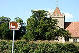 Tourist sign points towards historic church