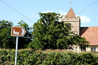 Tourist sign points towards historic church