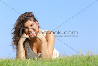 Portrait of an attractive woman lying on the grass