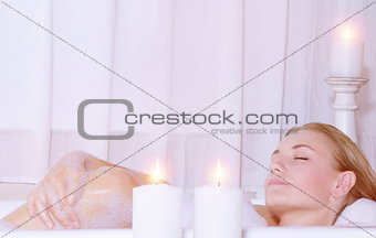 Beautiful woman taking bath