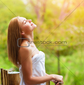 Calm woman on terrace