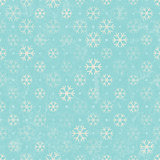 Seamless background with Christmas snowflakes.