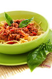 Spaghetti with meat, tomato and basil.